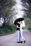 Couple. Young beautiful couple have fun under umbrella Royalty Free Stock Photo