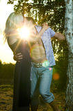 Couple. Romentic evening date on nature, couple on beautiful sunset kiss Royalty Free Stock Photo