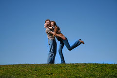 Couple. The enamoured couple embraces on a glade Stock Photo