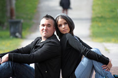 Couple. A couple sitting on the ground back to back Royalty Free Stock Photos