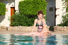 Couple. Women and men at pool stock image