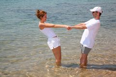 Couple. Man and women in water royalty free stock images