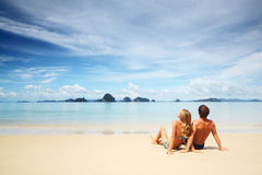 Couple. Young couple relaxing on a warm tropical sand Stock Photo