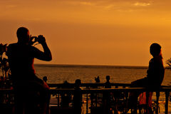 Couple. Taking photo at sun set Stock Photography