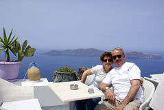 Couple. At cafeteria on Santorini island, Greece stock image