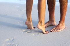 Couple. On the sandy beach Stock Images