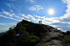 Couple. A silhoouette of couple climbing a montain Royalty Free Stock Photography