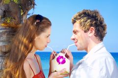 Couple. Portrait of attractive couple having date on the beach Stock Image