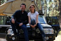 Couple on 4x4 road trip with roof tent Stock Image