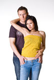 Couple. Caucasian guy and Asian posing romantically for their potrait Royalty Free Stock Photos