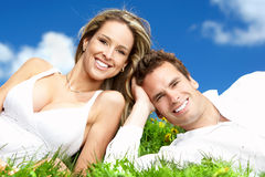 Couple. Young love couple smiling under blue sky Royalty Free Stock Photos