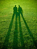 Couple. Together at the grass field, shadow Stock Photography
