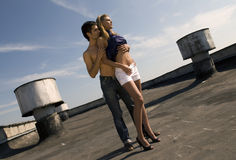 Couple. Young love couple staying under the roof Royalty Free Stock Image