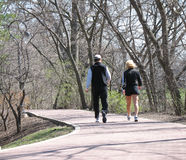 Couple. Walking on park trail royalty free stock photo