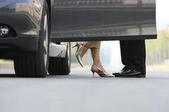 Couple. A couple beside the car Stock Photo