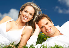 Couple. Young love couple smiling under blue sky Stock Photos