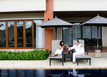 Couple. Attractive multicultural couple by the swimming pool Stock Photo