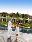 Couple. Attractive multi-cultural couple dancing by the swimming pool Stock Image