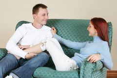 Couple 8. Couple enjoying each others company on a couch royalty free stock photography