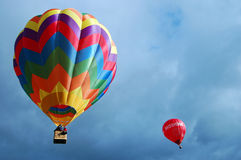 A couple. Of coloured ballooons flying over the Appennino country (Italy-Carpineti Royalty Free Stock Photography