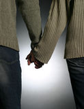 Couple. A young couple holding hands stock photography