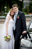 Couple. On the image there is bride and bridegroom.They are near car stock image