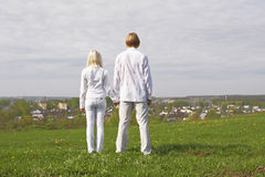 Couple. Standing on a green meadow Stock Photo