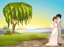A couple across the tree Stock Photo