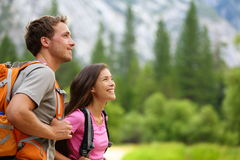 Couple - active hikers hiking in Yosemite Stock Images