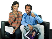 Couple of actors holding a headshot and a script. Waiting to audition and isolated on a white background Royalty Free Stock Photo