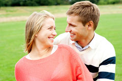 Couple admiring each other and smiling heartily Stock Photos