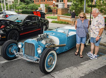 """Couple Admiring a """"Hot Rod"""" Royalty Free Stock Photo"""
