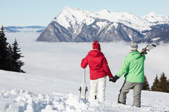 Couple Admiring Mountain View. Whilst On Ski Holiday In Mountains Stock Images