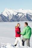 Couple Admiring Mountain View In Mountains Stock Photo