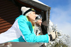 Couple admiring the nature of the snowy mountains Stock Photo