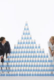Couple Admiring Pyramid Of Stacked Plastic Cups Stock Photo