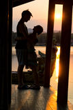 Couple admiring the sunset in Kanchanaburi, Thailand Royalty Free Stock Photos