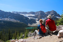 Couple Admiring View of Rocky Mountains Stock Photo