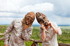 Couple in African masks Stock Photography