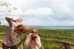 Couple in African masks Royalty Free Stock Photography