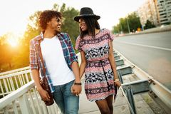 Couple of tourists taking a walk in a city street sidewalk in a sunny day stock image
