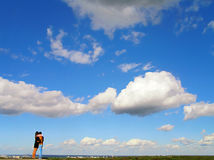 Couple against blue sky Stock Image