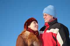 Couple against blue sky background Stock Photo