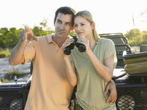 Couple Against Jeep With Binoculars  Stock Image