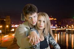 Couple against night city Stock Image