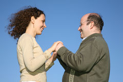 Couple against sky Stock Image