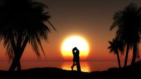 Couple against sunset sea with palm trees Royalty Free Stock Images