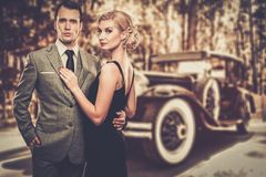 Couple against vintage car