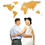 Couple against world map Royalty Free Stock Images