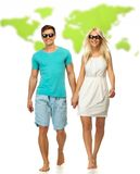 Couple against world map Stock Photos